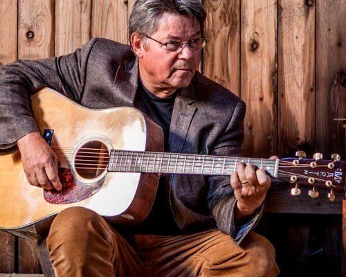 Billede for En mand med en guitar. Koncert med Erik Grip